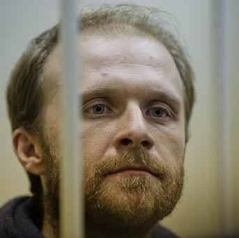 Russian freelance photographer Denis Sinyakov is one of two Greenpeace members to have been released on bail (AP)