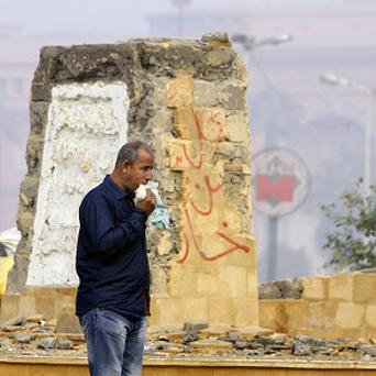 An Egyptian man walks in front of the foundation of a future memorial to protesters killed in the country's uprising (AP)
