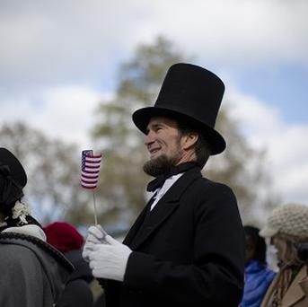 John Voehl, portraying president Abraham Lincoln, and wife Pamela stand during a ceremony commemorating the 150th anniversary of the dedication of the Soldiers National Cemetery and Lincoln's Gettysburg Address in Pennsylvania (AP)