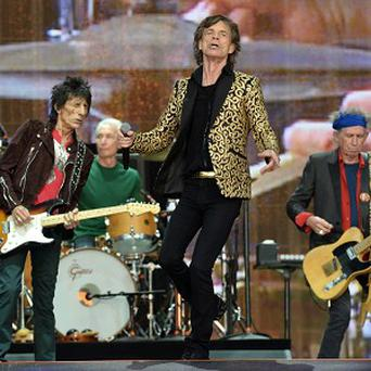 Mick Jagger, Ronnie Wood, Keith Richards and Charlie Watts on stage in Hyde Park, London.