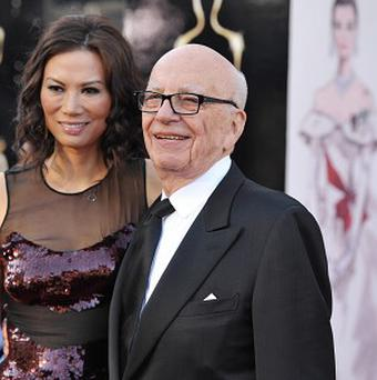 Rupert Murdoch and wife Wendi Deng Murdoch will appear in court to finalise their divorce. (AP/John Shearer/Invision)