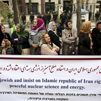 Hundreds of Iran's Jewish community rallied Tuesday in support of the country's disputed nuclear programme (AP)