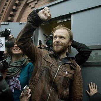 Russian freelance photographer Denis Sinyakov outside the gates of Kresty St Petersburg prison after he was released on bail (AP)