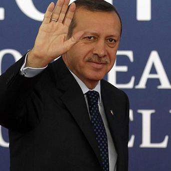 Turkish prime minister Recep Tayyip Erdogan was not in his office when a suspected bomber was arrested nearby