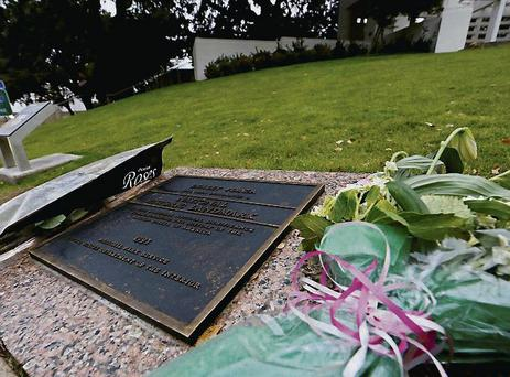 Flowers and a plaque at the base of the 'Grassy Knoll' at the spot where John F Kennedy was shot dead in 1963.