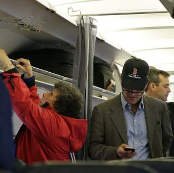 The US government is considering whether to allow mobile phones to be used on planes. (AP/Matt Slocum)