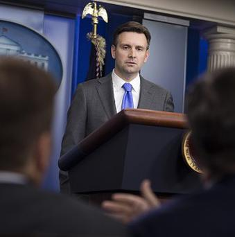 White House principal deputy press secretary Josh Earnest responds to a letter from the White House Correspondents Association and other news organisations accusing officials of blocking photos of President Barack Obama.(AP / Evan Vucci)