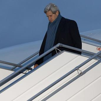 US Secretary of State John Kerry walks down the steps of his aircraft as he arrives at Geneva International airport (AP)