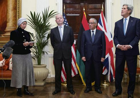 US Secretary of State John Kerry, alongside Libyan prime minister Ali Zeidan and UK Foreign Secretary William Hague with an interpreter in London yesterday.
