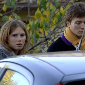 Knox and Sollecito shortly after the murder (AP)
