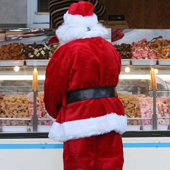 A Santa has been banned in the US after being charged with groping one of his female elves
