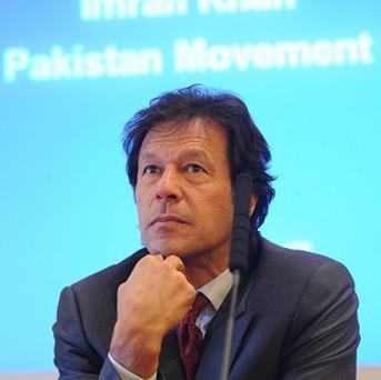 Imran Khan's political party has named a main it claims is the top CIA agent in Pakistan