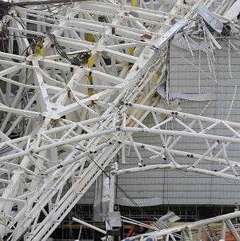 A metal structure buckled on part of the Itaquerao Stadium in Sao Paulo (AP)