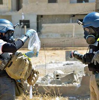 Members of the United Nations investigation team take samples in the Damascus countryside of Ain Terma, Syria (AP/Local Committee of Arbeen)