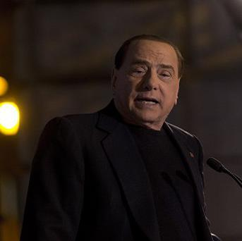 Silvio Berlusconi addresses his supporters during a rally in Rome on Wednesday
