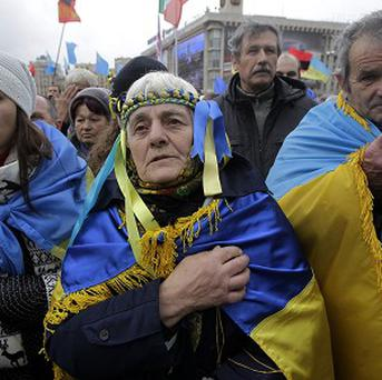 Demonstrators say prayers during a protest in support of Ukraine's integration with the European Union