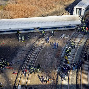 The train derailed on a curved section of track. (AP Photo/Craig Ruttle)