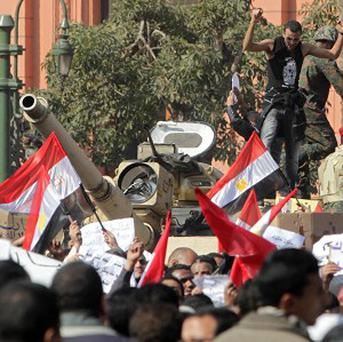 The scene in Tahrir Square, Cairo, Egypt, as anti-government protesters clash violently with supporters of President Hosni Mubarak as Egypt's political upheaval took a dangerous new turn.