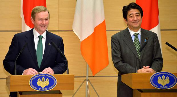 Irish Prime Minister Enda Kenny (L) smiles with his Japanese counterpart Shinzo Abe as they deliver their joint statement at Abe's official residence in Tokyo December 2, 2013.