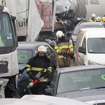 Scores of vehicles collided in fog on a Belgian autoroute (AP)