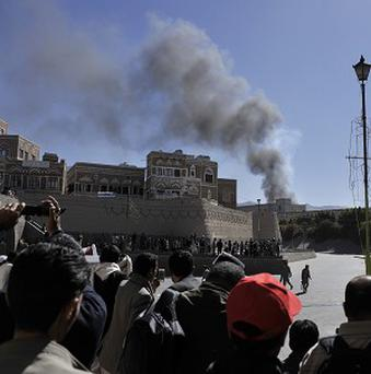Smoke rises after an explosion at the defence ministry complex in Sanaa, Yemen (AP)