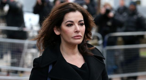 Nigella Lawson arrives at Isleworth Crown Court earlier today, December 5, 2013 in London, England for the trial of two sisters who are accused of fraud