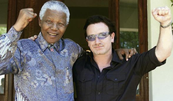 Nelson Mandela at his home with U2 frontman Bono in 2002.