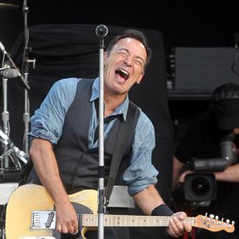 A lyric sheet for Bruce Springsteen's 1975 hit Born To Run has fetched £121,000 at auction.