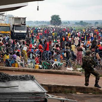 Christians gather at Bangui's airport as French military helicopters land (AP/Jerome Delay)
