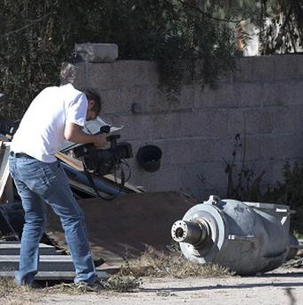 A cameraman films the radiation head part of a radiotherapy machine in the patio of a family who found the stolen equipment. (AP/Eduardo Verdugo)