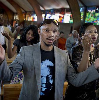 Mourners attend an early morning church service in memory of Nelson Mandela at the Regina Mundi church in Soweto, Johannesburg (AP)