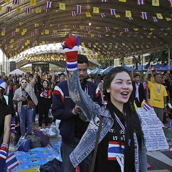 Anti-government protesters shout slogans at the Democracy Monument in Bangkok, Thailand (AP)