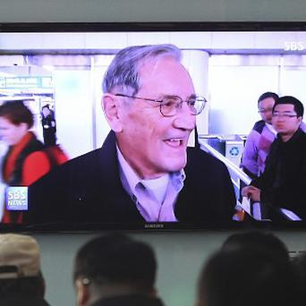 People at Seoul railway station in South Korea watch a TV news programme showing US citizen Merrill Newman after his release by North Korea (AP)