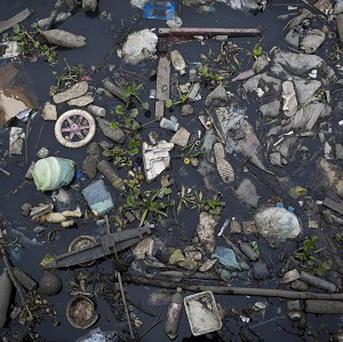 Rubbish floats on the polluted waters of Guababara Bay in Rio de Janeiro, Brazil. (AP)