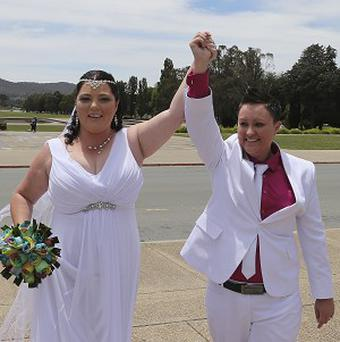 Stacey Cowan, right, and Corrina Peck celebrate after taking their wedding vows in Canberra. (AP)