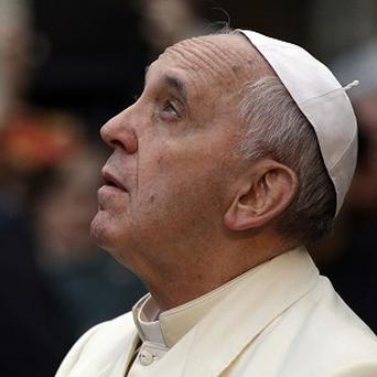 Pope Francis looks up at the statue of the Virgin Mary, on the occasion of the Immaculate Conception feast, in Rome (AP)