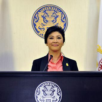 Thailand's prime minister Yingluck Shinawatra said she would dissolve the lower house of Parliament and call elections (AP)