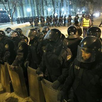 Ukrainian riot police guard government buildings in Kiev (AP)