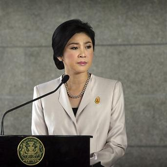 Thai premier Yingluck Shinawatra is defying opposition demands to step down