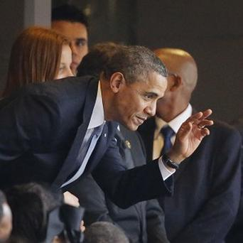 President Barack Obama waves to the crowd as he arrives for the memorial service (AP)