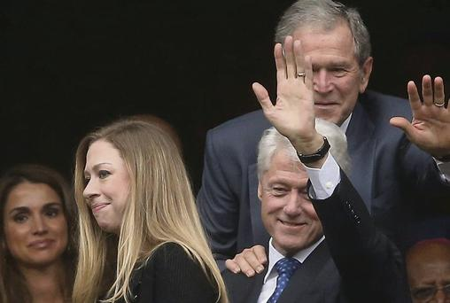 Former US presidents Bill Clinton and George W Bush with Chelsea Clinton