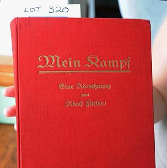 A Nazi-era copy of Mein Kampf signed by Adolf Hitler.