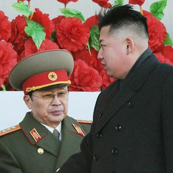 Jang Song Thaek was seen as helping Kim Jong Un consolidate power after the death of his father, Kim Jong Il, two years ago (AP/Kyodo News)