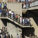 Members of the army and public watch the procession as the hearse carrying the body of Nelson Mandela drives towards the Union Buildings (AP)