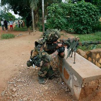 A French sniper takes position as troops evacuate Muslim clerics from the St Jacques Church in Bangui, Central African Republic (AP)