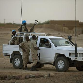 United Nations peacekeepers stand guard at a polling station, during presidential elections in Kidal, Mali (AP)