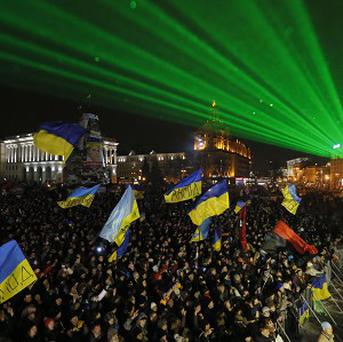Laser rays light over the crowd during a rally in Independence Square in Kiev (AP)