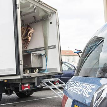 A gendarme car at a slaughterhouse in Narbonne, southern France, after officers from France's National Gendarmerie, accompanied by food safety and veterinary investigators, carried pre-dawn raids in 11 regions (AP)