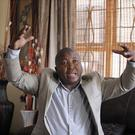 Fake Mandela sign language interpreter Thamsanqa Jantjie has been accused of being part of a murderous vigilante group (AP)