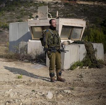 Israeli soldiers stand guard in Rosh Hanikra, Israel, near the border between northern Israel and Lebanon (AP)
